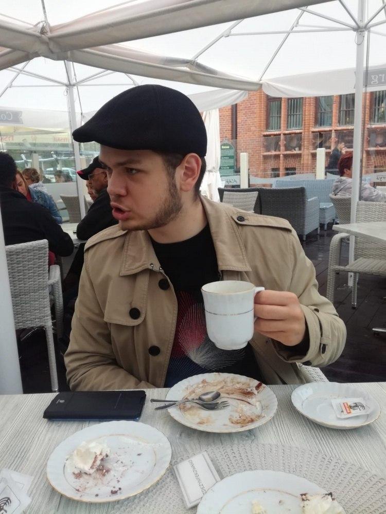 За чашкой кофе.